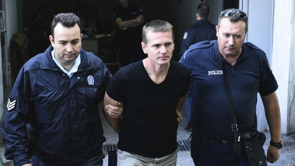 Obywatel Rosji Aleksander Winnik przy wyjściu z budynku sądu w Salonikach, Grecja - Sputnik Polska