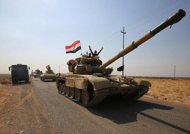 Irackie wojska przy wjeździe do miasta Kirkuk