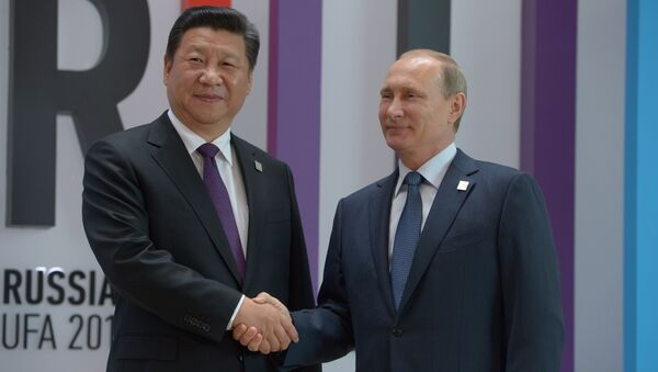 Przewodniczący Chińskiej Republiki Ludowej Xi Jinping i prezydent FR Władimir Putin na szczycie BRICS w Ufie - Sputnik Polska