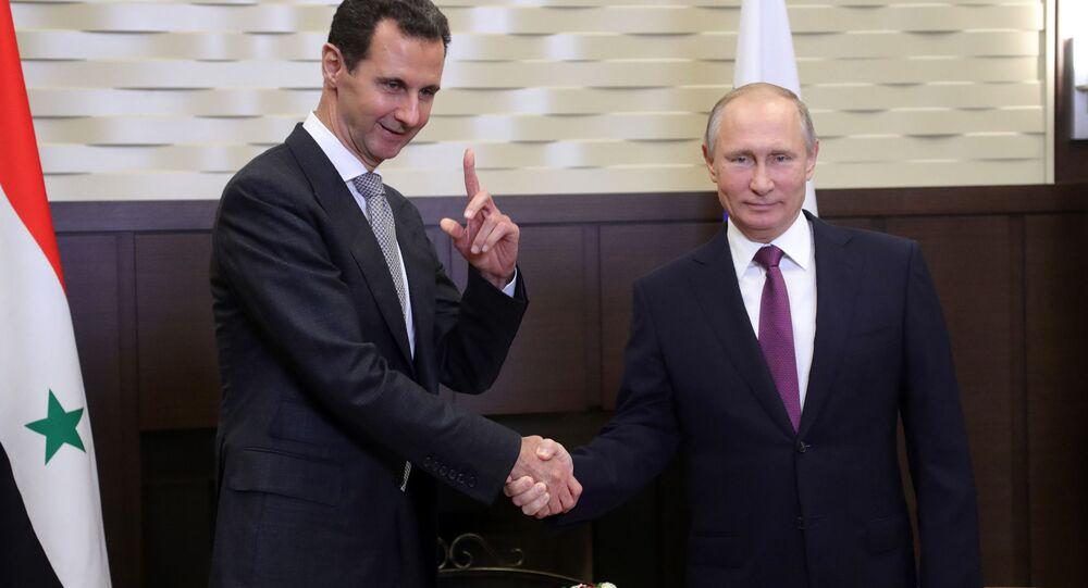 Prezydent Syrii Baszar al-Asad i prezydent Rosji Władimir Putin podczas spotkania