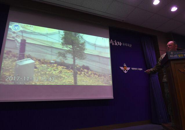 Nagranie ukazujące ucieczkę żołnierza z KRLD na ekranie w Seulu