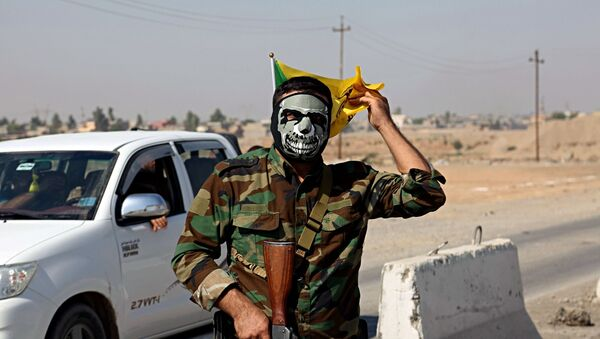 Przedstawiciel sił irackiej mobilizacji ludowej Al-Haszd asz-Sza'abi - Sputnik Polska
