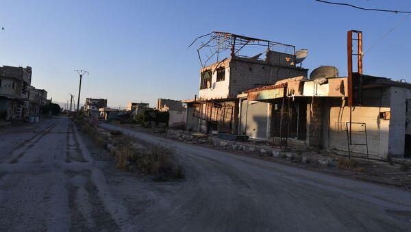 Budynki zniszczone w wyniku działań zbrojnych na przedmieściach Damaszku Wschodnia Guta - Sputnik Polska