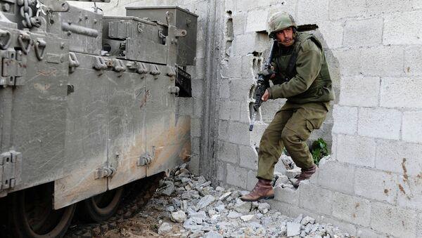 Izraelski żołnierz w Strefie Gazy - Sputnik Polska