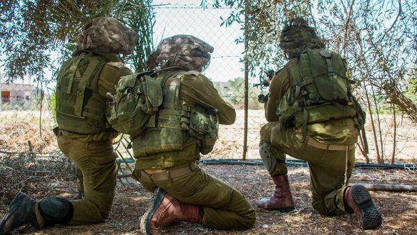 Izraelscy desantowcy w czasie operacji specjalnej w strefie Gazy - Sputnik Polska