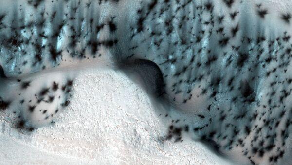 Zdjęcie powierzchni Marsa wykonane przez Mars Reconnaissance Orbiter - Sputnik Polska