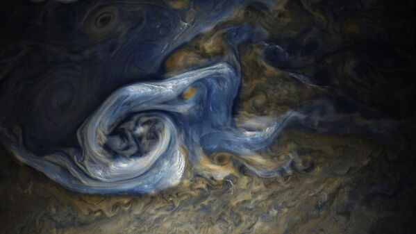 Automatyczna stacja Juno otrzymała niezwykle szczegółowe fotografie Jowisza, na których można zobaczyć gigantyczny huragan o wielkości jednej czwartej Ziemi. - Sputnik Polska