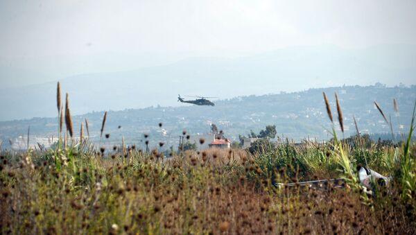 Rosyjski helikopter Mi-24 patroluje okolice bazy lotniczej Hmeimim w syryjskiej prowincji Latakia - Sputnik Polska