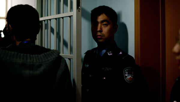 Ochroniarze w centrum dla więźniów w Pekinie - Sputnik Polska