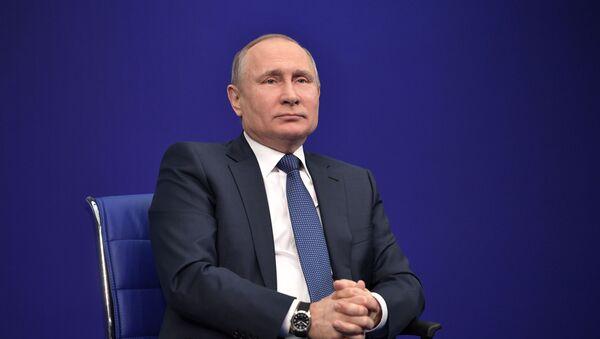 Kandydat na urząd prezydenta Rosji Władimir Putin w czasie przedwyborczego spotkania - Sputnik Polska