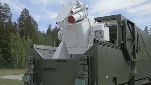 Obraz systemu laserowego podczas transmisji orędzia prezydenta Rosji Władimira Putina do Zgromadzenia Federalnego - Sputnik Polska