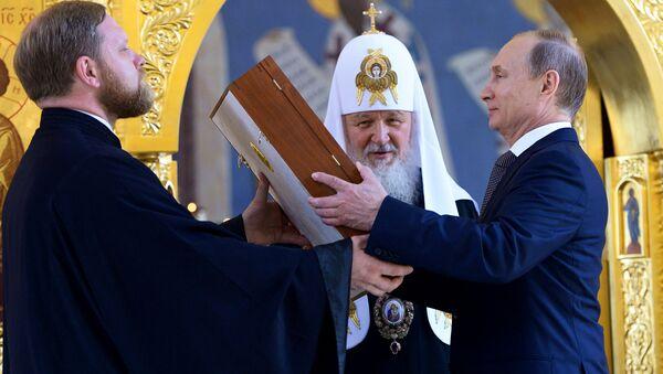 Jego Świątobliwość Patriarcha moskiewski i całej Rusi Cyryl I i Prezydent Rosji Władimir Putin w dniu obchodów rocznicy Chrzestu Rusi - Sputnik Polska