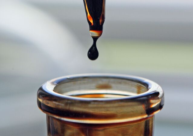 Dozownik kroplowy z olejem