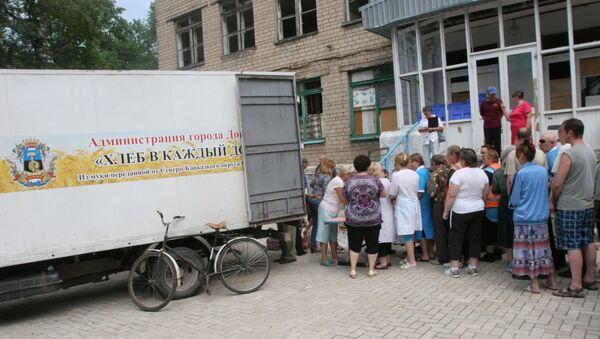 Rozdanie pomocy humanitarnej w Doniecku - Sputnik Polska