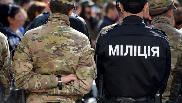 Pracownicy służb porządkowych Ukrainy w Kijowie - Sputnik Polska