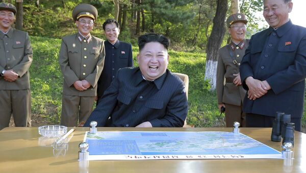 North Korean leader Kim Jong Un watches the test launch of a solid-fuel Pukguksong-2 at an undisclosed location in North Korea - Sputnik Polska