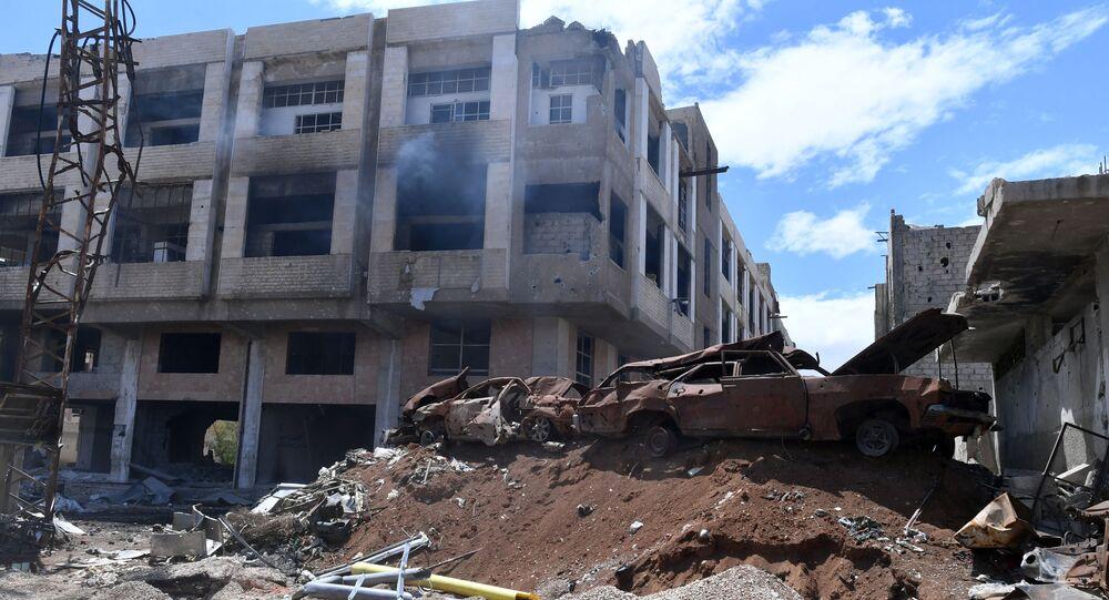 Zniszczone budynki na terenie byłego palestyńskiego obozu dla uchodźców Yarmuk na południowych przedmieściach Damaszku