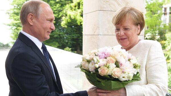 Spotkanie prezydenta Rosji Władimira Putina i kanclerz Niemiec Angeli Merkel w Soczi - Sputnik Polska
