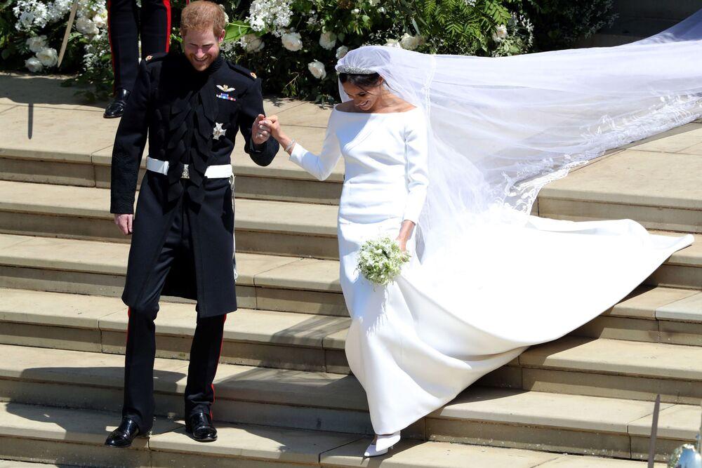 Książę Harry i Meghan Markle po ceremonii ślubnej w kaplicy Św. Jerzego na zamku królewskim w Windsorze