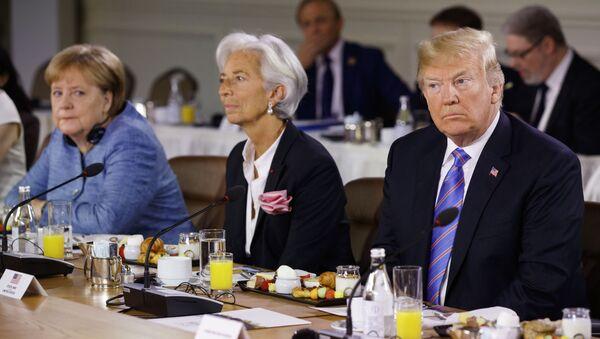 Kanclerz Niemiec Angela Merkel, szefowa MFW Christine Lagarde i prezydent USA Donald Trump na szczycie G7 w Kanadzie - Sputnik Polska