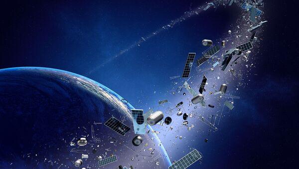 Śmieci kosmiczne krążące dookoła Ziemi - Sputnik Polska