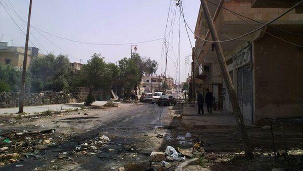 Zniszczenia na ulicach syryjskiego miasta Dara. Zdjęcie archiwalne - Sputnik Polska