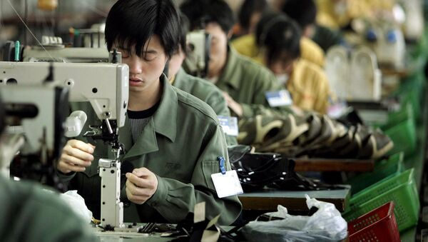 Pracownicy szwalni w chińskim mieście Wenzhou - Sputnik Polska