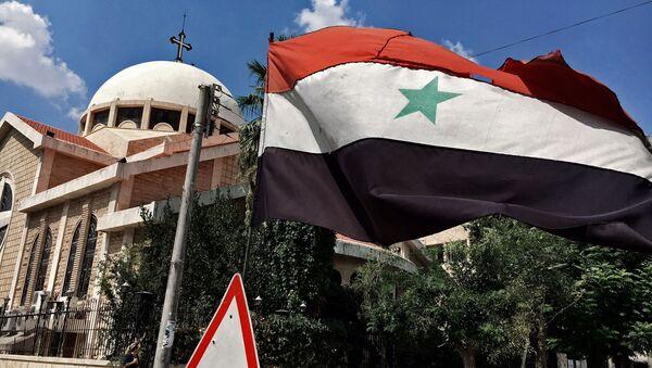 Flaga Syrii w Aleppo - Sputnik Polska