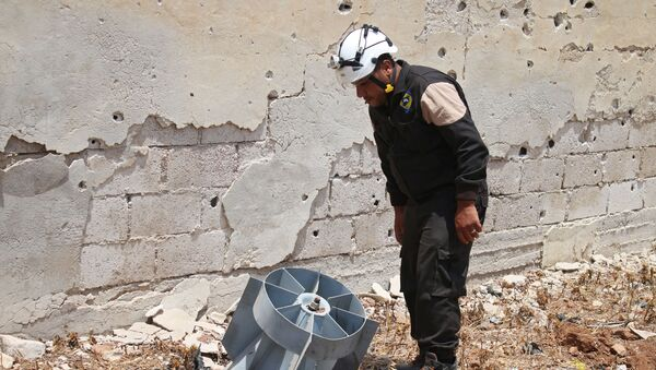 Członek organizacji Białe Hełmy w Syrii - Sputnik Polska