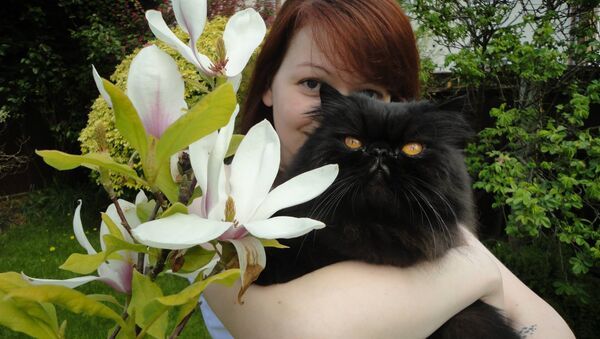 Ms Skripal pictured with one of her father's two cats - one has died and the other is missing - Sputnik Polska