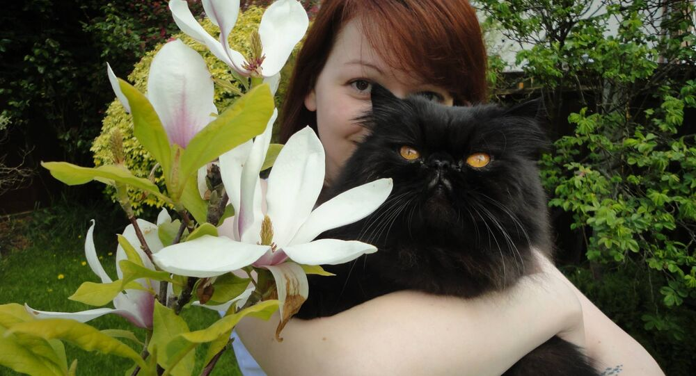 Ms Skripal pictured with one of her father's two cats - one has died and the other is missing