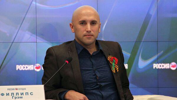 Dziennikarz Graham Phillips - Sputnik Polska