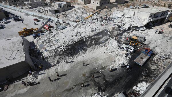 Zniszczony magazyn z bronią, prowincja Idlib, Syria - Sputnik Polska
