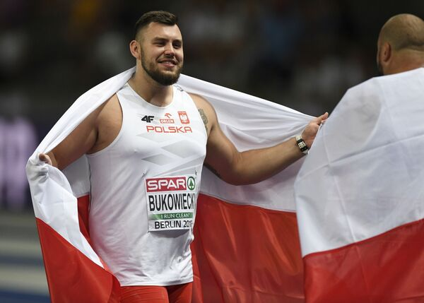 Michał Haratyk zdobył złoty medal a Konrad Bukowiecki srebrny medal w pchnięciu kulą, Berlin - Sputnik Polska
