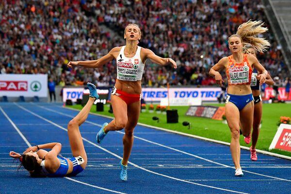 Złoty medal w sztafecie kobiet 4x400 m w składzie Małgorzata Hołub-Kowalik, Iga Baumgart-Witan, Patrycja Wyciszkiewicz, Justyna Święty-Ersetic - Sputnik Polska