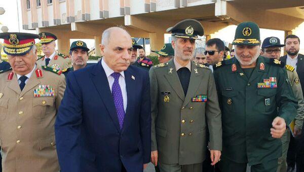 Minister obrony i wsparcia sił zbrojnych Iranu Amir Hatami podczas swojej wizyty w Syrii - Sputnik Polska
