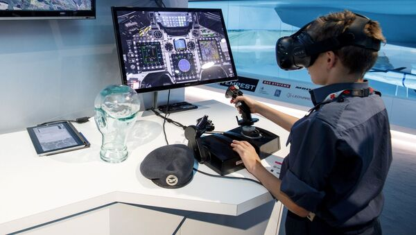 Chłopiec podczas gry w symulatorze lotów BAE Systems - Sputnik Polska