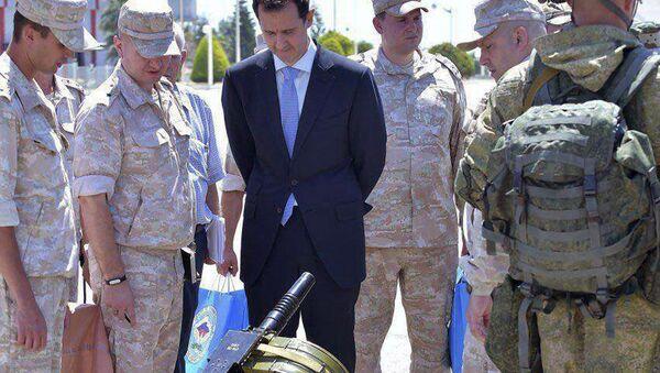 Prezydent Syrii Baszar Asad w rosyjskiej bazie wojskowej w Hmeimim - Sputnik Polska