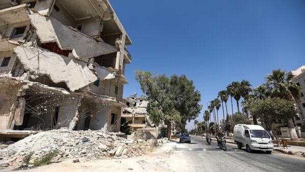 Zniszczone budynki w mieście Idlib, Syria - Sputnik Polska
