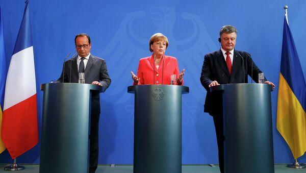 Petro Poroszenko, Angela Merkel i Francois Hollande v Berlinie - Sputnik Polska