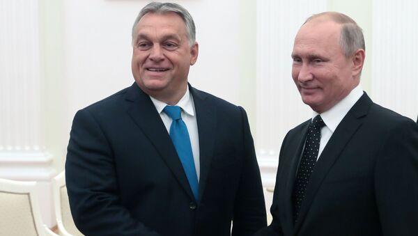 Prezydent Rosji Władimir Putin i premier Węgier Wiktor Orban w czasie spotkania - Sputnik Polska