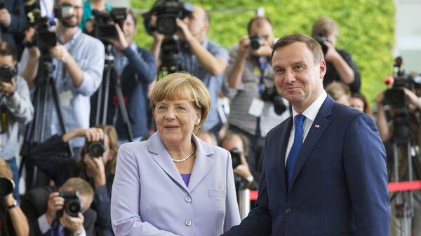Канцлер Германии Ангела Меркель и президент Польши Анджей Дуда на встрече в Берлине - Sputnik Polska