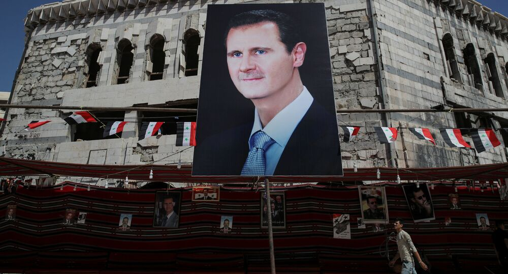 Plakat ze zdjęciem Baszszara al-Asada