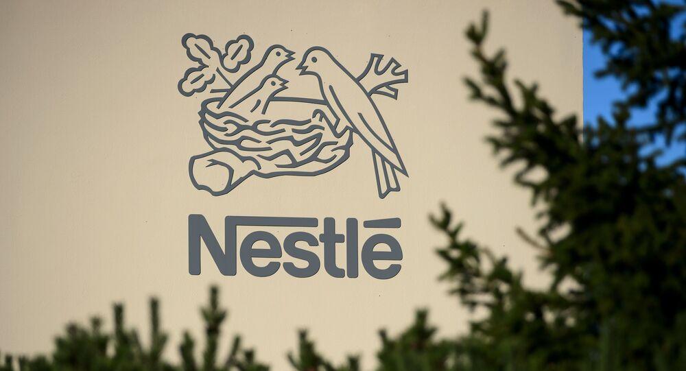 Logo szwajcarskiej wielonarodowej korporacji i największego na świecie producenta żywności Nestle