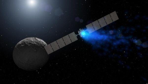 Ilustracja przedstawiająca sondę Dawn zbliżającą się do planety Ceres - Sputnik Polska