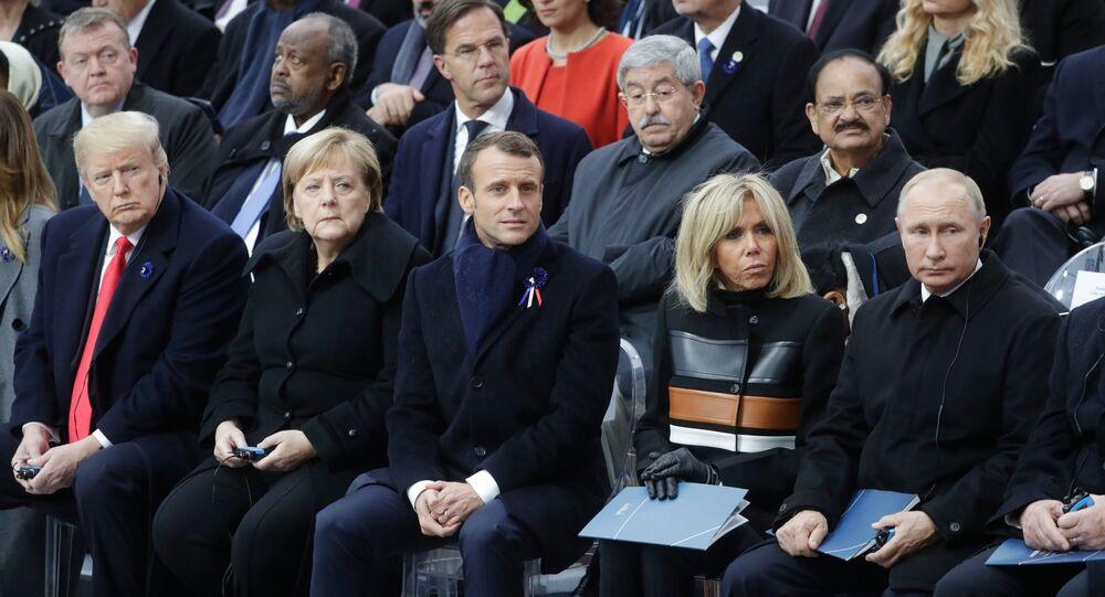 Donald Trump, Angela Merkel, Emmnuel Macron, Brigitte Macron y Vladímir Putin