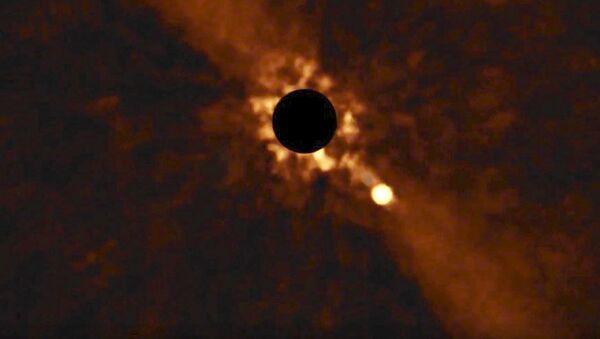 Kadry obracania się planety Beta Pictoris b wokół swojej gwiazdy - Sputnik Polska