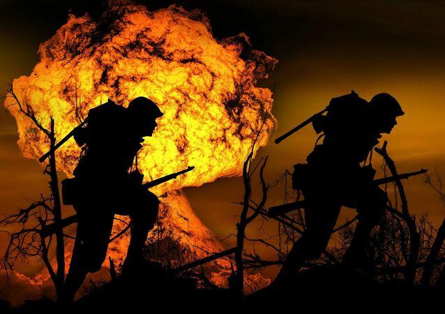 Żołnierze na tle płomieni