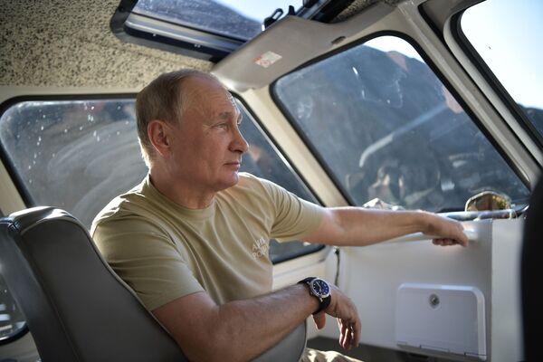 Prezydent Federacji Rosyjskiej Władimir Putin podczas urlopu w Rezerwacie Sajano-Szuszenskim w Republice Tywy - Sputnik Polska