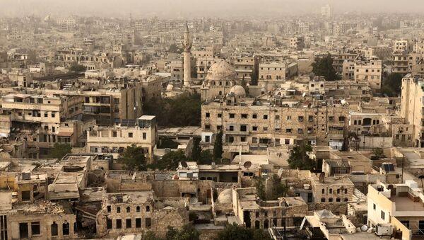 Zniszczone i uszkodzone w wyniku działań wojskowych budynki w Aleppo - Sputnik Polska